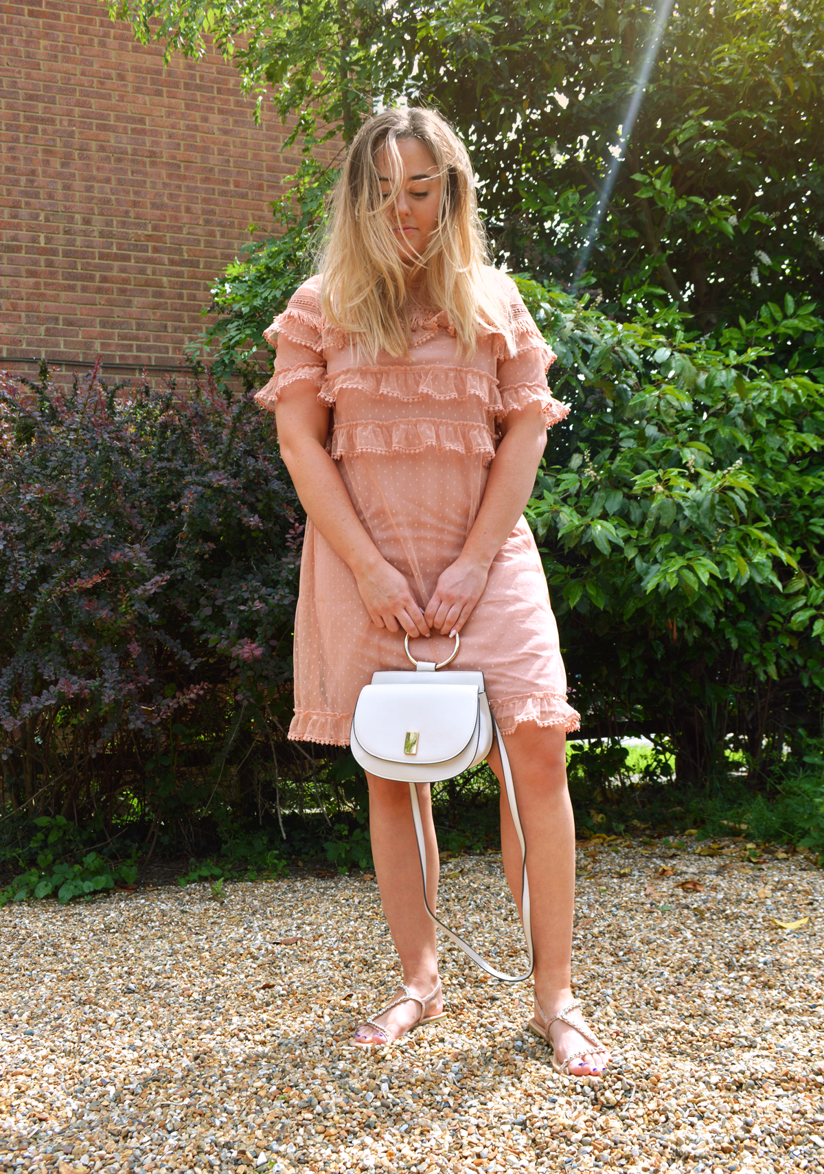 Hannah wearing Asos River Island blush pink dobby dress with tiered chiffon and lace, holding the Mango bag
