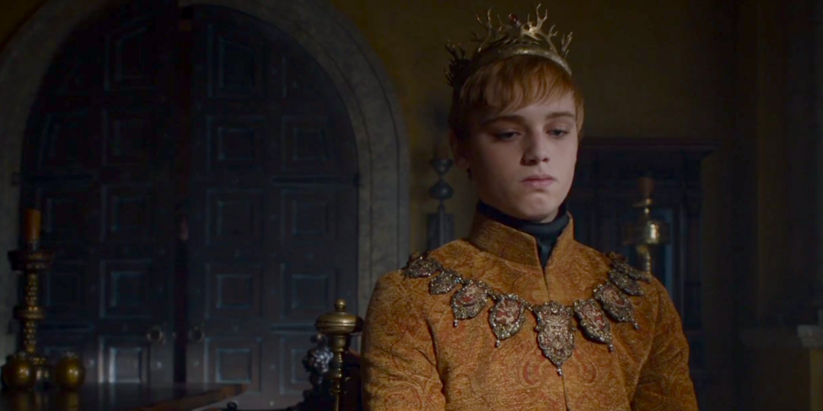 Tommen as King in the last episode of season six, wearing an orange gown
