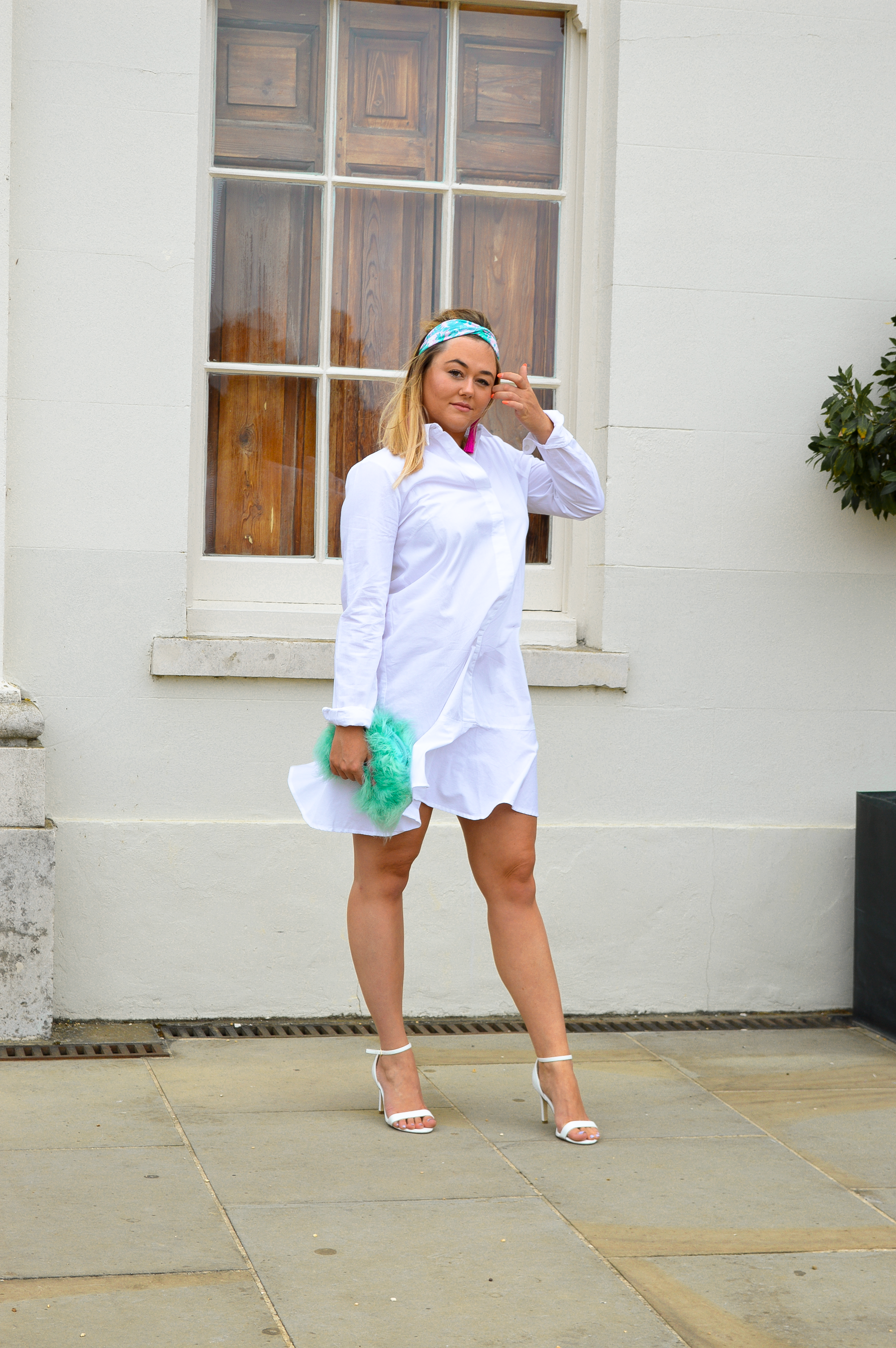 Hannah wears shirt dress, fluffy green bag and headband