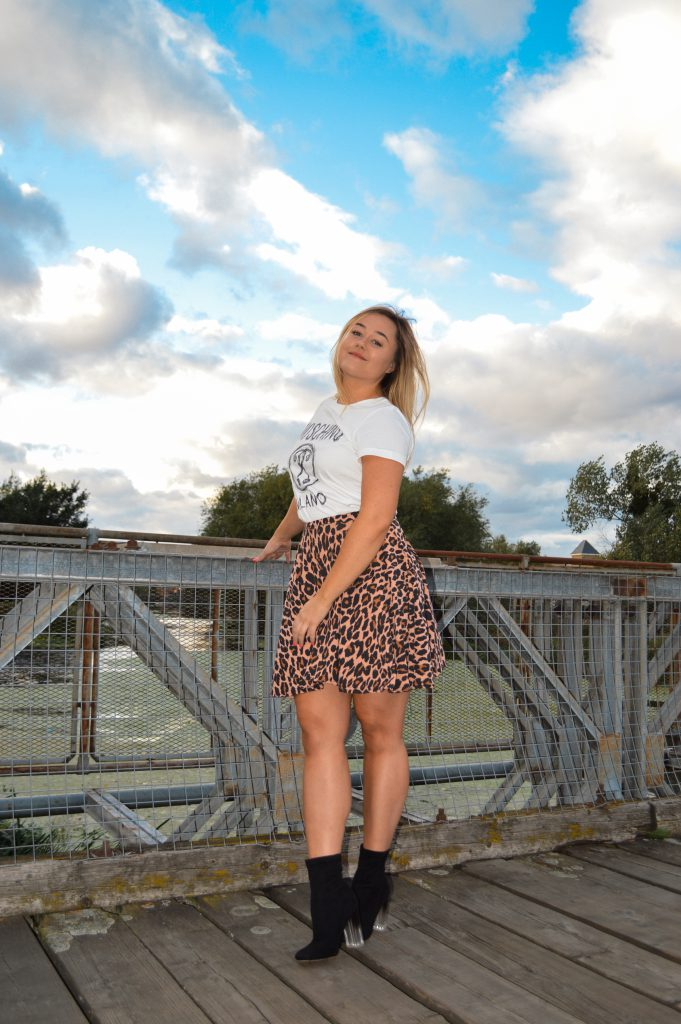 Hannah wears a Moschino T shirt and a leopard print skater skirt