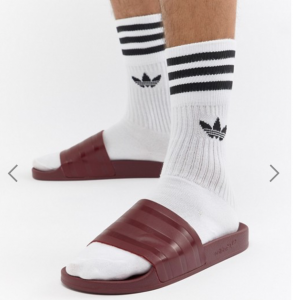 Man wears socks with adidas sliders